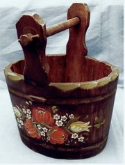 kleiner ovaler Holzkübel mit Griffstange -