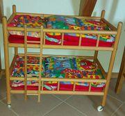Puppenbett aus Holz mit Bettwäsche