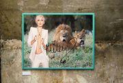 Miley Cyrus mit zwei Löwen