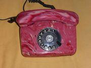 Drehscheibentelefon rotmarmoriert und rar