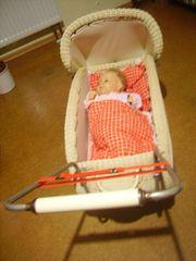 Puppenwagen geflochten Radaufhängung mit Lederbändern