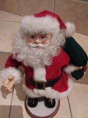 Weihnachtsmann singend