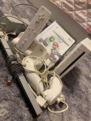 Wii mit Konsolen und Mariokartspiel