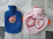 Verkaufe 2 schöne Kinderwärmflaschen - Unbenutzt
