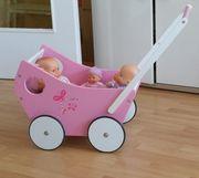 Puppenwagen aus Holz Lauflernwagen rosa