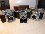 Vier antike Zeiss Kameras ab