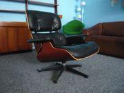 Charles Eames Lounge Leder Kirsche