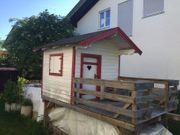 Kinderhaus aus Massivholz 160 x