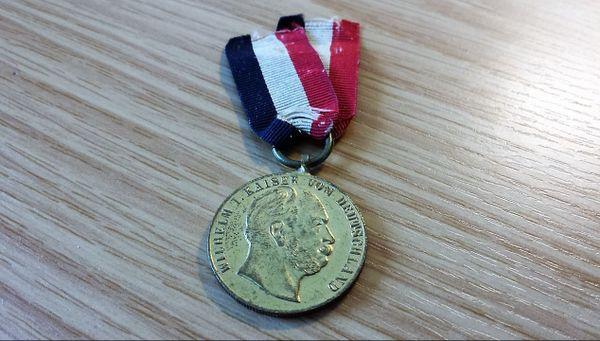 Medaille am Band Orden Deutsches