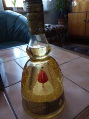 Ballerina in Goldwasser Flasche