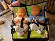 Puppenwagen mit 2 Babypuppen