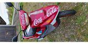 Scooter 50 als Coca-Cola Optik