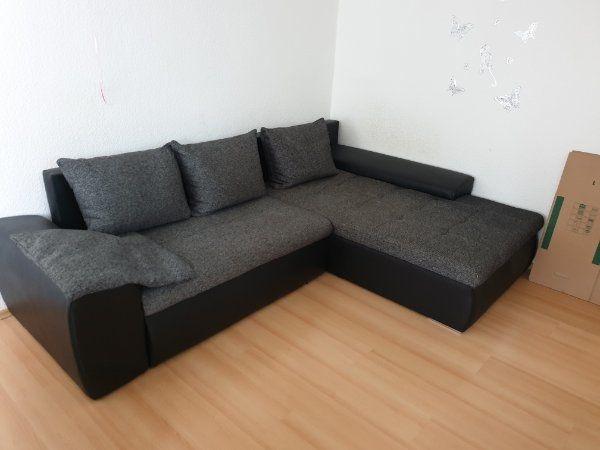 Couch mit Schlaffunktion in L