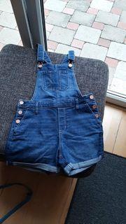 Neuwertige Jeans-Latzhose kurz von H