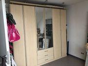 Kleiderschrank mit Falt- und Spiegeltüren