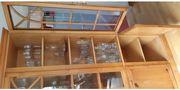 Holzschrank aus Vollholz mit Glastüren