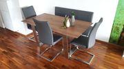 Nußholz Esstisch mit Schwing-Stühlen