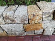 Granit Mauerstein grau gespalten