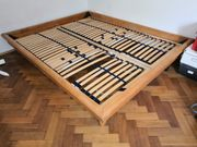 Doppelbett aus geöltem Holz inkl