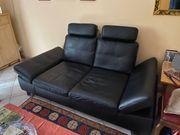 Ledercouch und Sessel