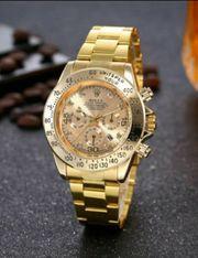 Schöne Armbanduhr Farbe Gold für
