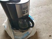 Kaffeemaschine mit Mahlwerk und timer