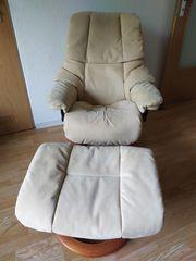 Sessel mit Hocker der Marke