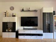 Moderne Wohnwand weiß schwarz 4-teilig