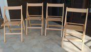 4 Klappstühle aus Holz