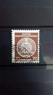 Dienstmarke der DDR gestempelt Zirkelbogen