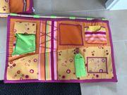 Bett-Tasche und Kissen