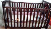 Babygitterbett kolonialfarben