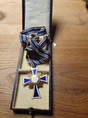 Mutterkreuz vergoldet am Band mit
