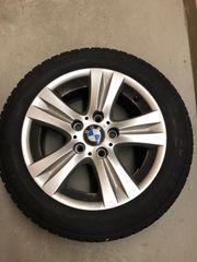 4 Winterreifen mit BMW Felgen