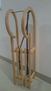 Holzschlitten neuwertig noch nie benutzt