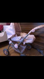 sehr schöner Puppenwagen in rosa