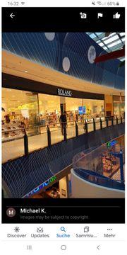 ROLAND Schuhverkäuferin - Loop 5