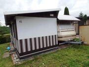 Feststehender Wohnwagen mit vollisoliertem Vorzelt