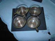 Teegläser mit Kupferhaltung