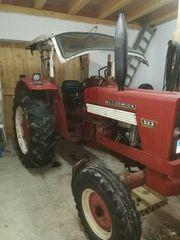 Traktor schlepper mit mistreuer triebachse
