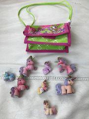 Acht Filly Pferde mit Tasche