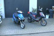 zwei Roller TGB und Kleiner