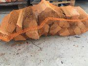 verkaufe Brennholz im Sack