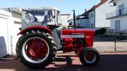 Traktor IHC MComick Gummiwagen Kegelspalter