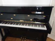Klavier schwarz glänzend gebraucht