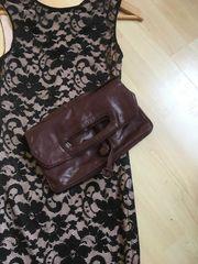 Lederhandtasche oder Clutch