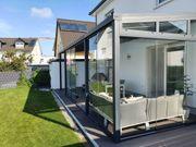 Terrassendach mit Schiebeelementen und Sonnenschutz