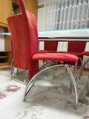 Glastisch mit 6 Stühlen