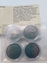 vier 1-DM-Münzen