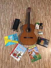 3 4 Gitarre mit Bücher